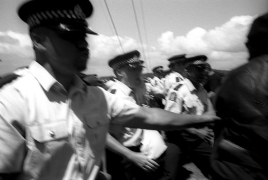 ©Tamara Voninski. New Zealand police move in on a group of Maori protesters shouting abuse on Waitangi Day (New Zealand's National Day) in the Bay of Islands in New Zealand.   The Treaty of Waitangi was signed in 1840 between the Maori and the British who agreed to live together peacefully. In 2005, the New Zealand government passed the controversial Seabed and Foreshore legislation to prevent Maori from claiming exclusive ownership of New Zealand2019s resource rich coastline and seabed. The Maori traditionally see themselves as caretakers of the land and coastline.  The Maori population is approximately 530,000 of four million New Zealanders.