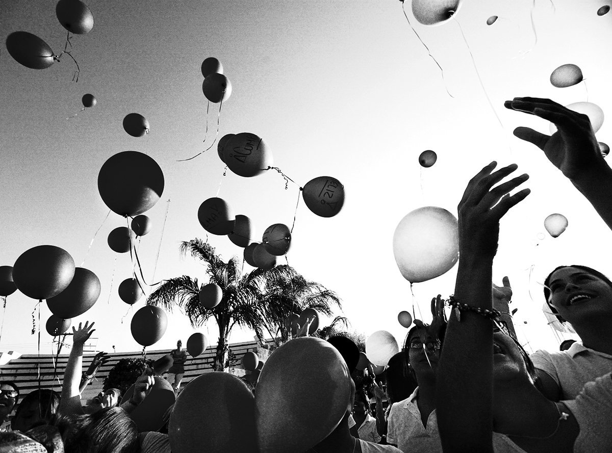 Nearly 500 women and girls released purple balloons, the recognized color in the fight against domestic violence,  in Esteban Baca Calderon Square as part of a International Women's Day silent march. Reportedly the largest march organized by women in Nuevo Laredo, Mexico's history, August, 3, 2007