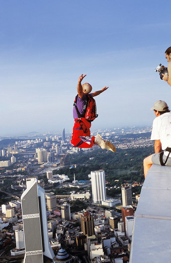 Menara Kuala Lumpur  International Tower Jump, KL, Malaysia.  I had fun being tied to the tower and leaning over the edge to photograph, but I don't think I'd jump...and the base jumpers called me crazy?!