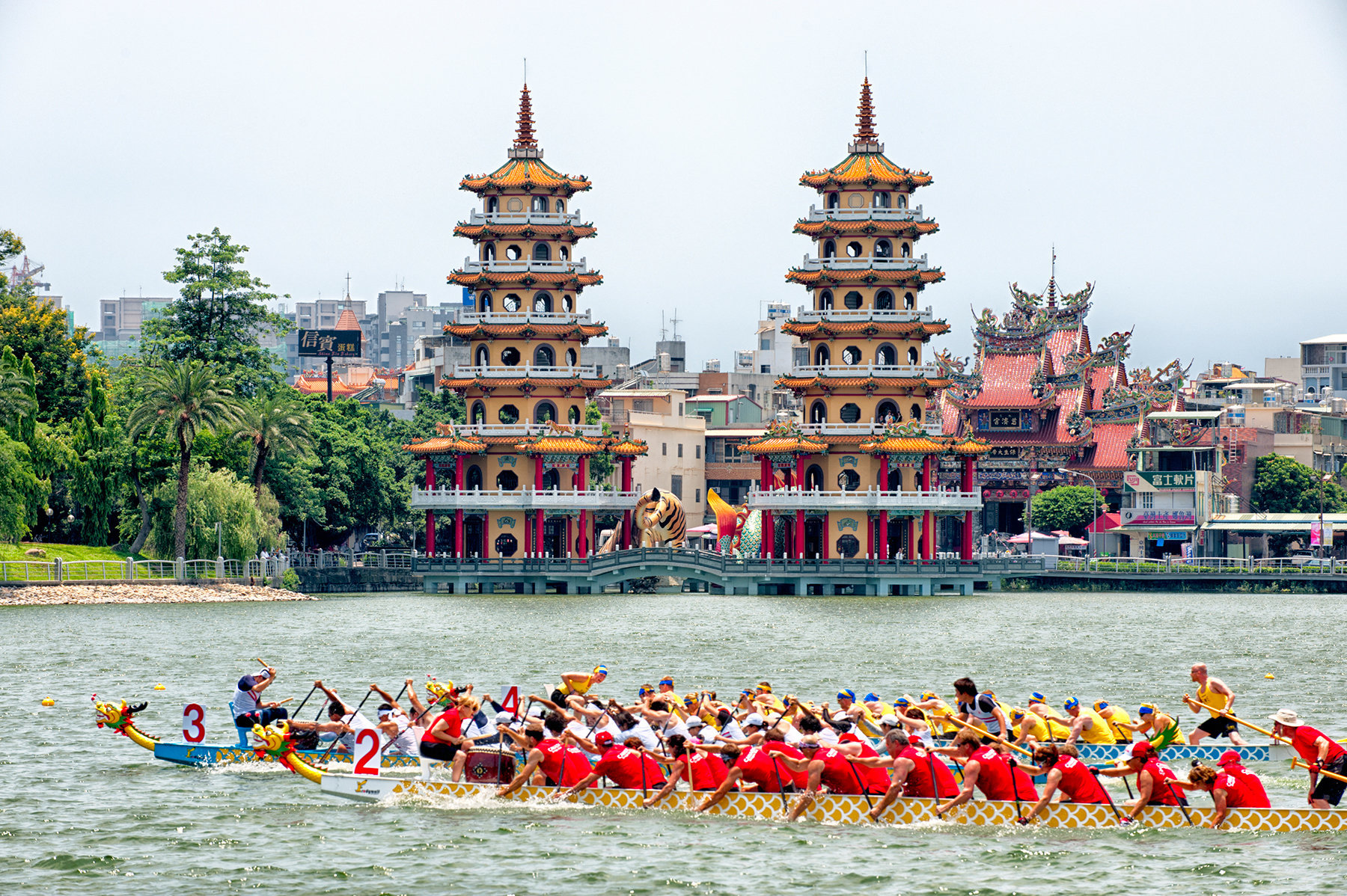 Dragon Boat races in front of Dragon and Tiger Pagodas, Lotus Pond, Kaohsiung, Taiwan
