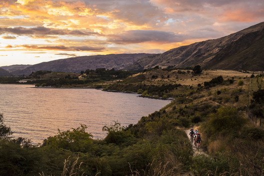 Team Heartland Ricoh riding back towards Wanaka from Glendu Bay at sunrise after paddling through the night. Most teams only slept a total of 8-10 hours during the whole race.