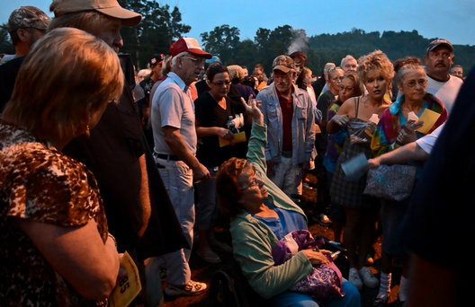 Hopeful patients wait for their number to be called before the sunrises over the Wise County Fair Ground.