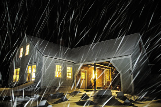 I used this picture for our christmas card one year.  I had a long exposure set and then I took a spotlight and shone it very briefly on the house and the falling snow.