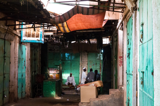 Subtle light and muted colours in a Khartoum alley.