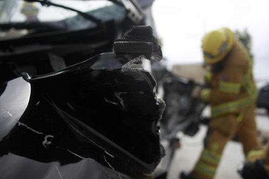 A firefighter cuts off a metal panel from a mangled Mercedes during a vehicle extrication training exercise on Friday.
