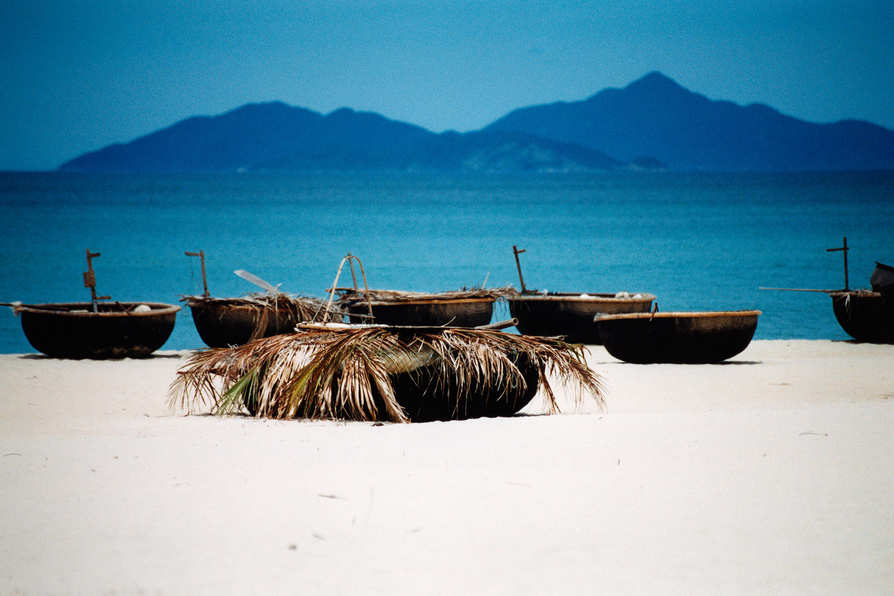 Vietnam, fishing boats on China Beach, Bai non nuoc. China Beach, near Da nang, on the South China Sea, was an in-country R & R retreat for US servicemen during the Vietnam war. It was also the home to 510th Evacuation Hospital.  Today, it's simply one of Vietnam's many beautiful beaches; it is a gorgeous 18 mile (30 km) stretch of fine white sand running from near Danang to Hoi An.
