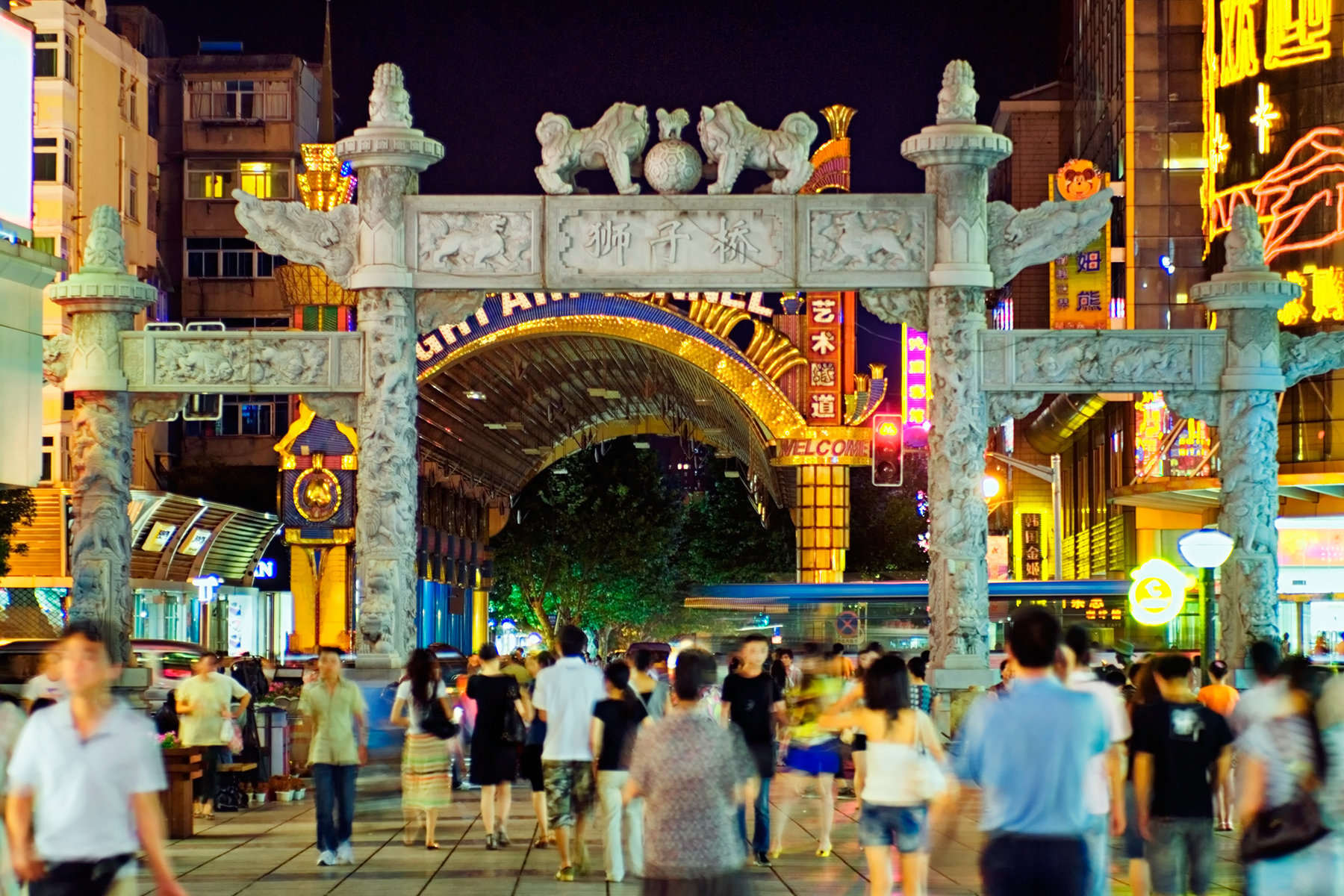 China, Nanjing, Hunan Road, Old stone gateway to pedestrian area at night