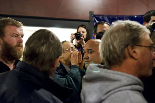 A protestor yells at Rick Perry after a talk at a coffeeshop in Aimes, Iowa on December 11th, 2011.