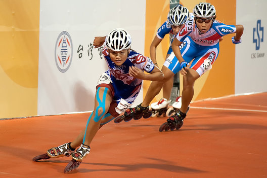 Yu-ting Huang of Chinese Taipei (Taiwan) leads Jin-seon Lim of Korea, and the rest of the pack, in roller sports speed inline skating, 500m Sprint, Women's Final, World Games, Kaohsiung, Taiwan, July 19, 2009. Yu-ting Huang won the gold medal and Jin-seon Lim won the silver medal.