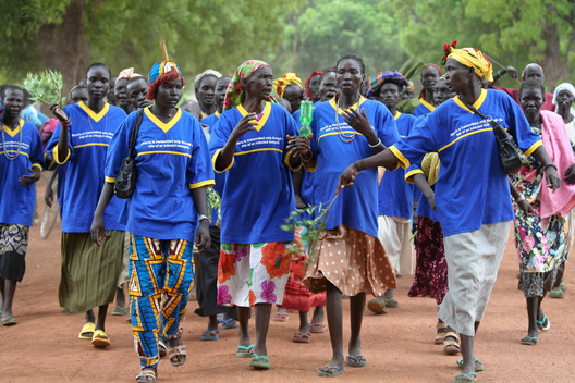 "Supported by the international NGO, Population Services International (PSI), a women's group in Rumbek, South Sudan parades on Africa Malaria Day 2006 to raise awareness about malaria prevention.  The women sport shirts stating, ""Malaria is transmitted only through the bite of an infected mosquito."""
