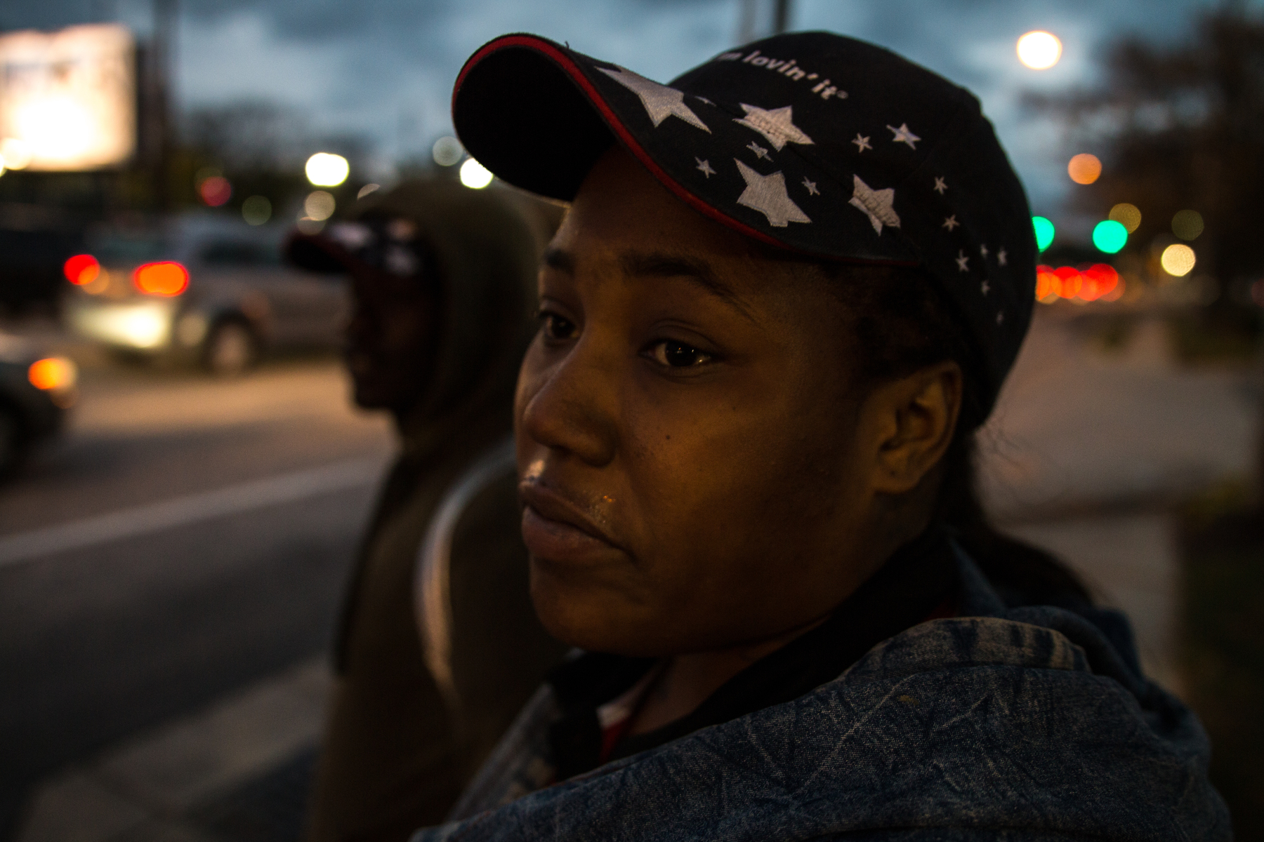 Mary Brown waits for a bus after getting off a shift at McDonalds the day after Trump was elected as the American President. She said she was disappointed Trump won.