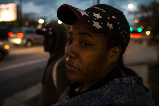 "Baltimore/November 9, 2016 - Mary Brown waits for a bus after getting off a shift at McDonalds the day after the American election. She said she was upset that Americans had elected Trump. ""It's a sad day. I still can't believe it."""