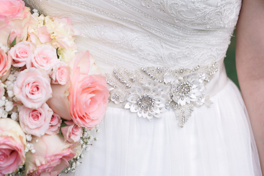 belt on bride's gown with flowers