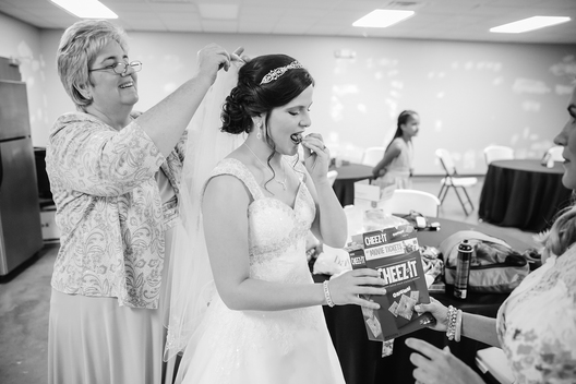 bride snacking on Cheezits