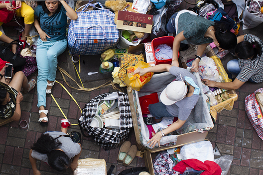 Filipino workers package items to send home during their day off for the Tueng Ng Festival, Hong Kong