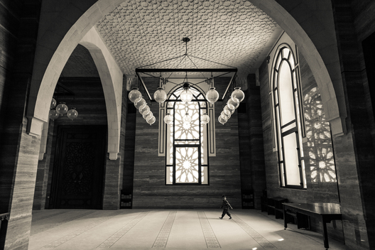 Rather than joining his father in prayer, this little boy was more interested in exploring Al-Fateh Mosque in Bahrain.