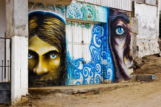 A door with dramatic Graffiti in a coastal village on the Chilean coast