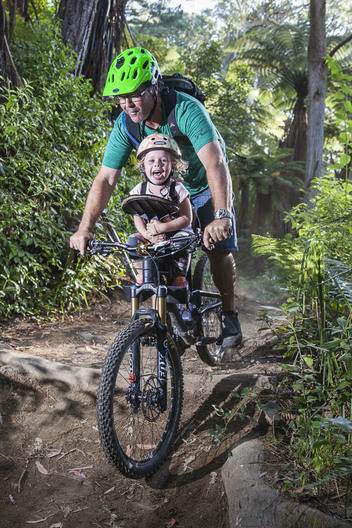 A dad sharing his love for the dirt with his daughter on the trails near Rotorua New Zealand.