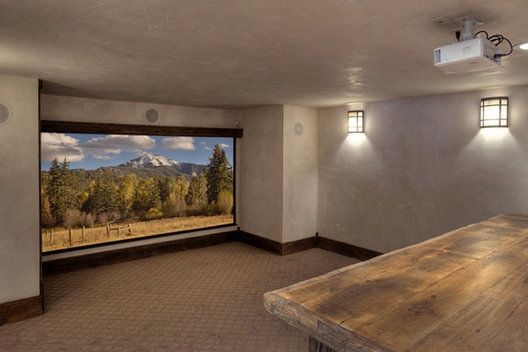 We nestled this theater space between the kitchen sitting room and the Game room. State of the art projector technology was installed as well as a bartop for sports and beer fans who want a full game experience.