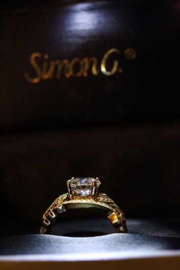 gold engagement ring with large diamond
