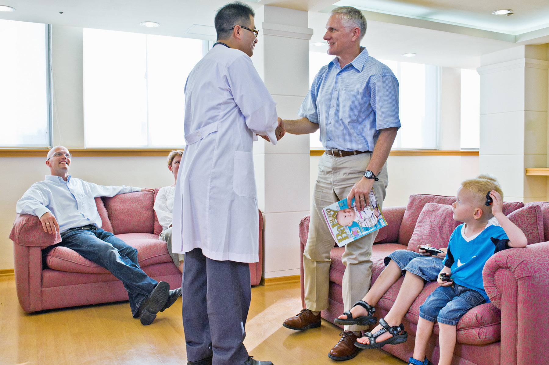 Doctor greeting patients in International Health Services Center at Kuang Tien General Hospital, Shalu, Taichung, Taiwan