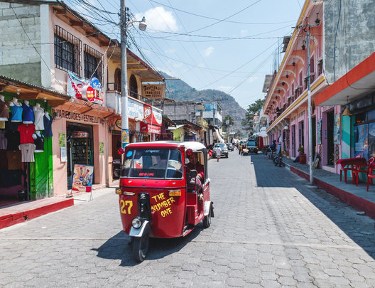 Tuk-tuk drives through the streets of Panajachel by lake Atitlan.