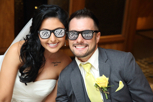 wedding couple wearing bride and groom sunglasses