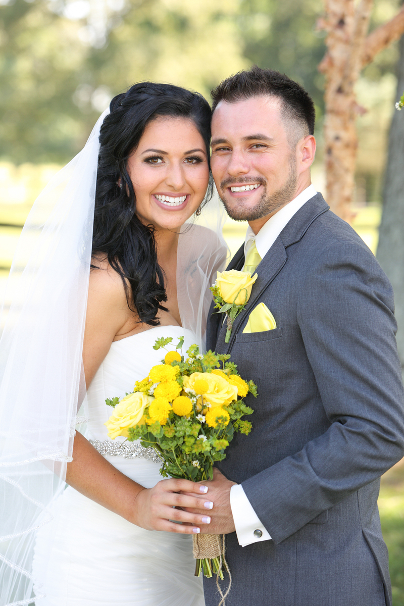 wedding couple with yellow flowers