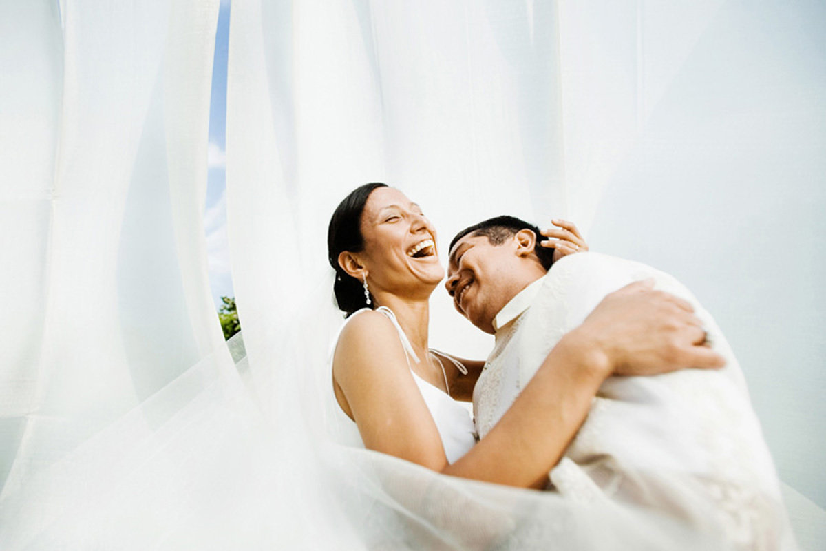 Couple laugh in this wedding portrait at the Aurora Inn