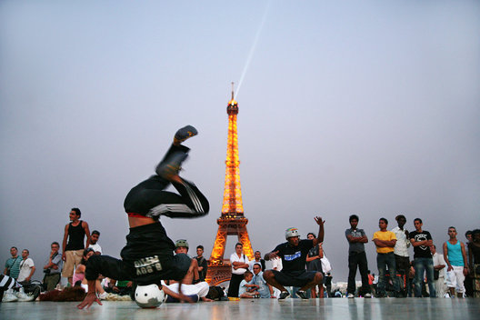 Break dancers perform at the Palais de Chaillot with the Eiffel Tower in the background
