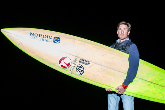 "Shane Desmond of Santa Cruz, California with a 9'8"" (pictured) and 9'10"" by Screwball industries. ""It's shaped by a friend whom I pretty much grew up with, and I've been riding his boards for about 15 years."""