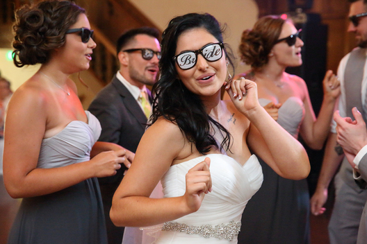 bride dancing and wearing bride sunglasses