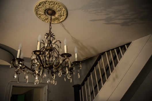 The one nice thing in the house is a chandelier.