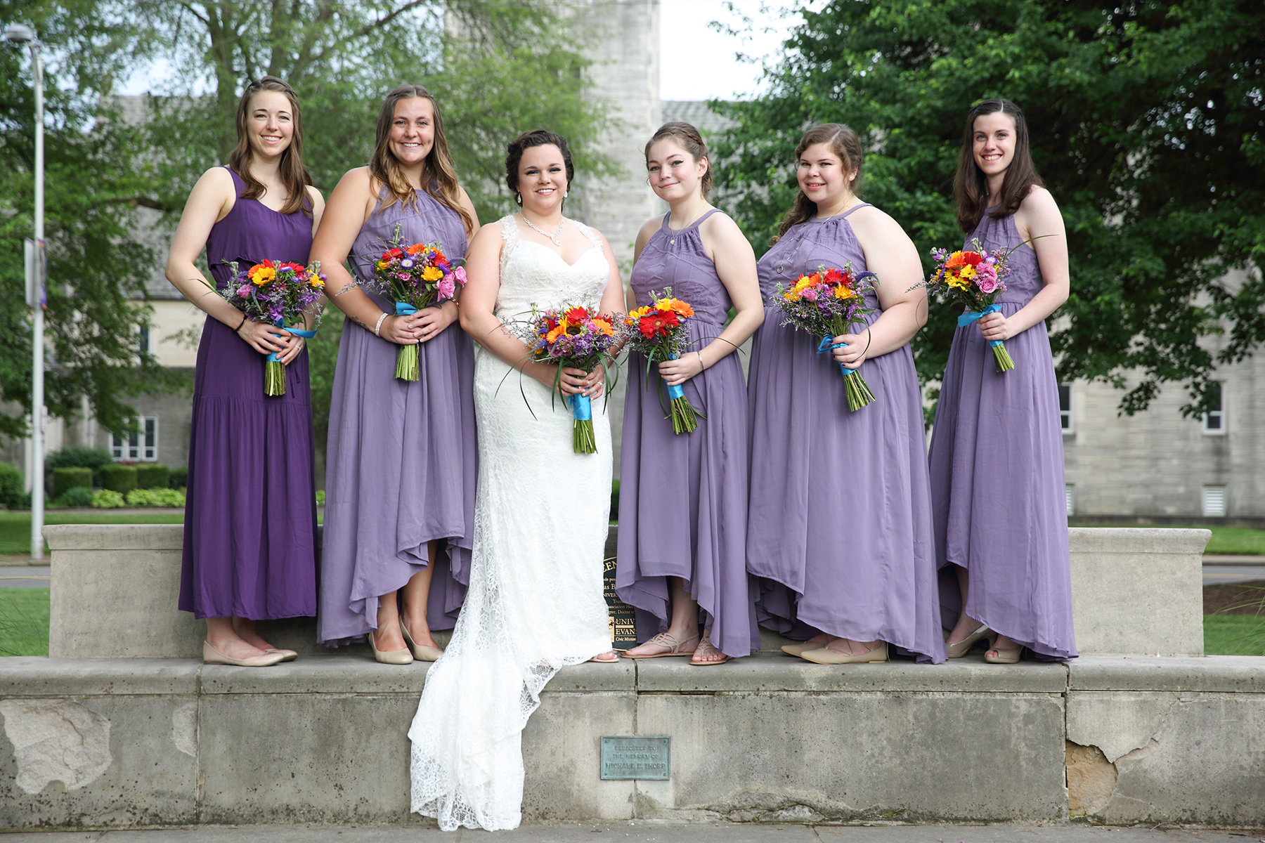 Bridesmaids equinox photography evansville indiana wedding bride with bridesmaids in purple dresses ombrellifo Choice Image