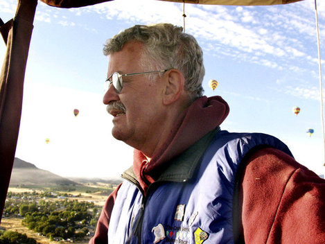 "Chuck Reynolds pilots his hot air balloon ""Tree Top Flyer"" over the city of Montague on a crisp fall morning during the Montague Rotary Balloon Festival. Reynolds said he named his balloon after a song that reminded him of a friend that had died."