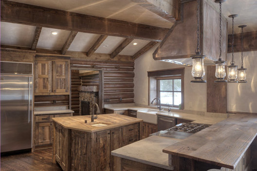 This charming and cozy kitchen embraces function, state of the art appliances in with the warmth of wood and lantern lights.