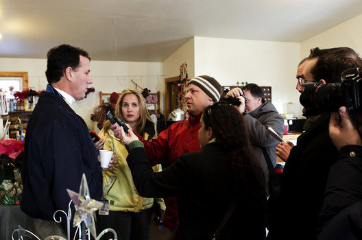 Rick Santorum  answers questions from the press at Howell Tree Farm.