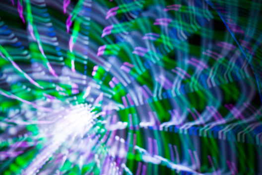 "A combination of photography techniques called ""focus blur"" and ""zoom blur"" are used to transform the lights of the ferris wheel into abstract designs at the Montgomery County Agricultural Fair in Gaithersburg, Maryland."
