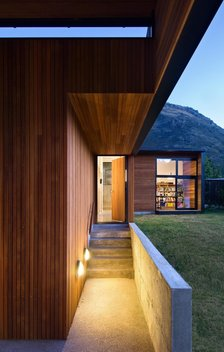 The cedar lined courtyard links the two primary forms of the house.