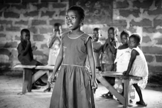 A young girl sings a morning welcome.