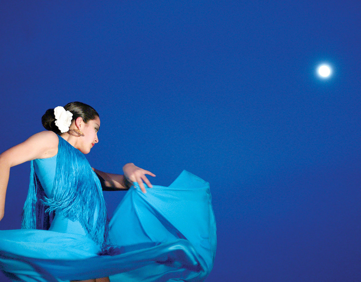 Samantha Mabel Garza dances outside under a nearly full moon to Duetos de Guitarras with the Texas A&M International University Flamenco group at the opening of the Smithsonian exhibit at the university, Thursday, March, 1, 2007.
