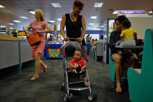 Caressa talks with a friend she bumps into at Chuck E Cheese.