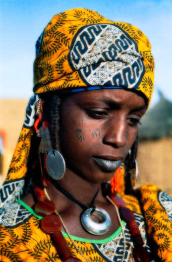 A woman in the village of Diagourou near Tera, Niger wears the traditional silver jewelry of the Fulani people.