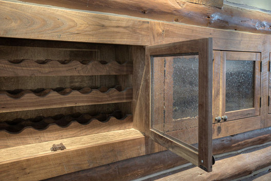 This custom wine storage cabinet features a 400 bottle maximun and glass doors to keep dust out. Seeded glass add to the old cabin look.