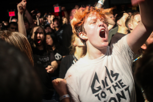 "New York, New York/October 4, 2016 - A girl dances in the moshpit at a Bad Religion concert one month before the American election. The seminal punk band was touring with Against Me!, which is fronted by transgender rocker Laura Jane Grace. Grace has been a leading advocate for gender equality and LGBTQ rights and famously burnt her birth certificate on stage in North Carolina to protest their ""bathroom bill""."