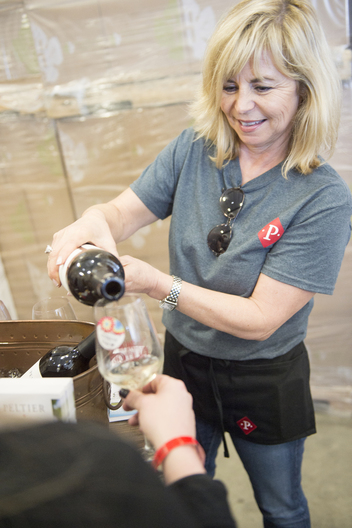 Owner of Peltier Winery Gayla Schatz pours wine for a customer at the annual Lodi Wine and Chocolate festival at their new tasting room in Acampo, Ca. Dario Leventini / Lodi New Sentinel