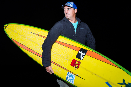 "Ben Wilkinson of Narabeen, New South Wales, Australia, with his backup 9'6"" surfboard by FCD."