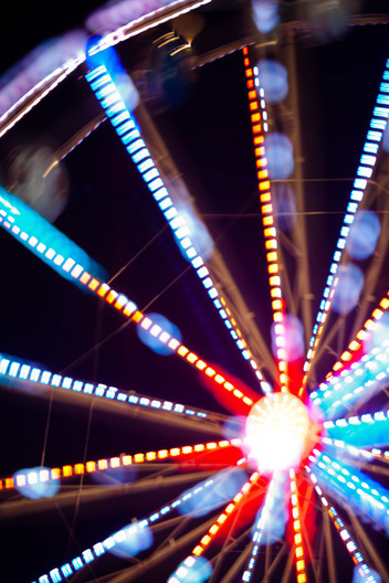 "A photography technique called ""focus blur"" is used to transform the lights of the ferris wheel into abstract designs at the Montgomery County Agricultural Fair in Gaithersburg, Maryland."