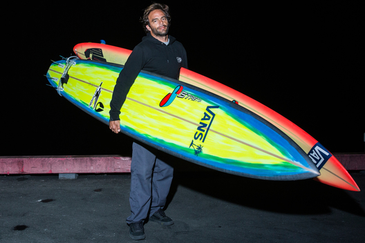 "Nathan Fletcher of San Clemente, California holding a 10'2"" and a 10'10"" by Stretch Boards. ""Stretch has been making my boards for about 12 years and I usually ride a four-fin. The reason I ride a 10'2"" is for the paddling. [It does well] in the waves and conditions we're going to face today. The 10'10"" is made a little thinner so I can get away with it in smaller surf but it's technically made for bigger Mavericks."""