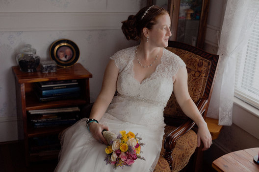 Location portrait of bride, beautifully lit by window light. 